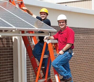 Tech installing solar panels