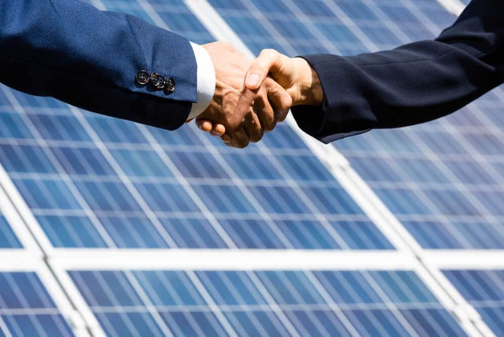 Businessman & Businesswoman Hand - Small Energy Bill